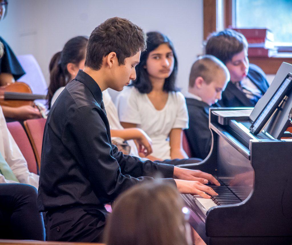NCCMI student playing the piano