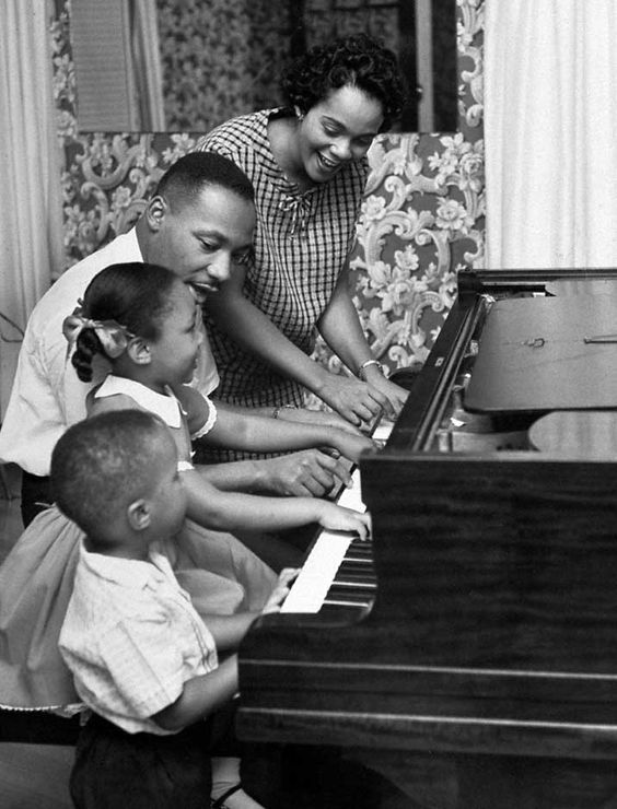 Martin Luther King, Jr., and family at the piano